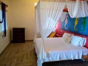 "Bed – ""Caballito de Mar"" - Beach House Room - Treasure by The Sea Resort"