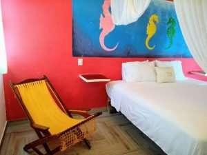 "Bed & Chair – ""Caballito de Mar"" - Beach House Room - Treasure by The Sea Resort"
