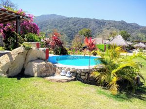 """Pool – """"Casa del Paraíso"""" – Happy Hill Room - Treasure by The Sea Resort"""