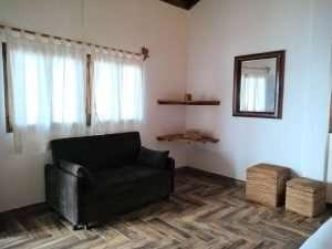 """Couch & Shelf – """"La Casa de Arbol"""" - Beach House Room - Treasure by The Sea Resort"""