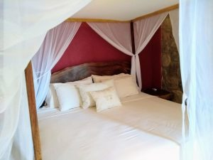 """Bed – """"La Casa de Sirena"""" - Beach House Room - Treasure by The Sea Resort"""