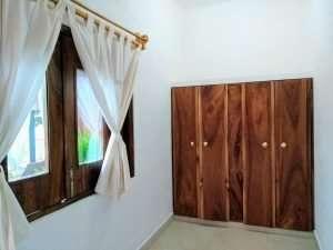 """Closet & Window – """"La Casa de Sirena"""" - Beach House Room - Treasure by The Sea Resort"""