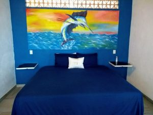 """Bed – """"La Casa del Pez Vela"""" - Beach House Room - Treasure by The Sea Resort"""