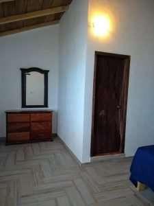 """Dresser, Mirror & Front Door– """"La Casa del Pez Vela"""" - Beach House Room - Treasure by The Sea Resort"""