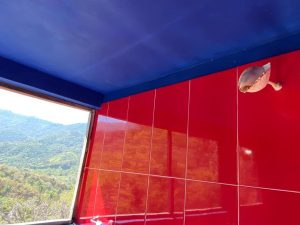 "Shower with Conch Shell Showerhead – ""Las Chicas Bailando"" – Happy Hill Room - Treasure by The Sea Resort"