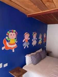 """Artwork – """"Las Chicas Bailando"""" – Happy Hill Room - Treasure by The Sea Resort"""