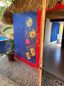 """Front of Cabana – """"Las Chicas Bailando"""" – Happy Hill Room - Treasure by The Sea Resort"""