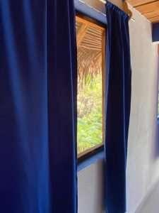 """Bedroom Window View – """"Las Chicas Bailando"""" – Happy Hill Room - Treasure by The Sea Resort"""