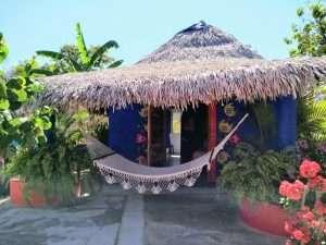 """Front of Cabana & Hammock– """"Las Chicas Bailando"""" – Happy Hill Room - Treasure by The Sea Resort"""