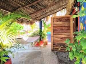 """Hammock – """"Las Chicas Bailando"""" – Happy Hill Room - Treasure by The Sea Resort"""