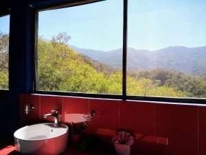 """Bathroom View – """"Las Chicas Bailando"""" – Happy Hill Room - Treasure by The Sea Resort"""