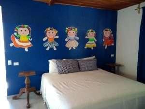 """Bed – """"Las Chicas Bailando"""" – Happy Hill Room - Treasure by The Sea Resort"""