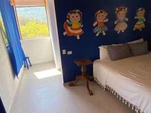 """Bedroom going into Bathroom – """"Las Chicas Bailando"""" – Happy Hill Room - Treasure by The Sea Resort"""