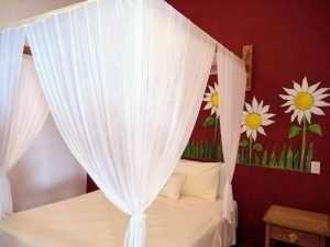 "Bed – ""Los Girasoles"" - Beach House Room - Treasure by The Sea Resort"