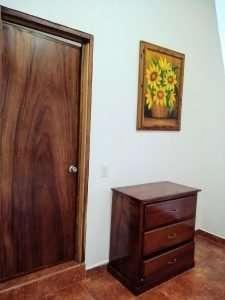 """Dresser & Front Door – """"Los Girasoles"""" - Beach House Room - Treasure by The Sea Resort"""