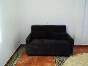 """Couch – """"El Delfin"""" - Beach House Room - Treasure by The Sea Resort"""
