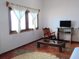 "Ocean View Window, Coffee Table, Rocking Chair, TV – ""El Delfin"" - Beach House Room - Treasure by The Sea Resort"