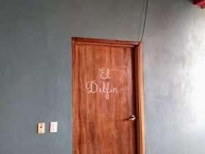"""Front Door – """"El Delfin"""" - Beach House Room - Treasure by The Sea Resort"""