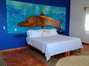"""Bed – """"El Delfin"""" - Beach House Room - Treasure by The Sea Resort"""
