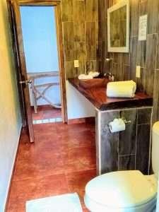 """Bathroom Sink – """"El Delfin"""" - Beach House Room - Treasure by The Sea Resort"""