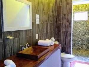 """Bathroom – """"El Delfin"""" - Beach House Room - Treasure by The Sea Resort"""